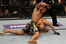 FAIRFAX, VA - MAY 15:  (L-R) Rafael Dos Anjos punches Kamal Shalorus in a lightweight bout during the UFC on Fuel TV event at Patriot Center on May 15, 2012 in Fairfax, Virginia.  (Photo by Josh Hedges/Zuffa LLC/Zuffa LLC via Getty Images)