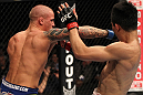 "FAIRFAX, VA - MAY 15:  (L-R) Dustin Poirier punches ""The Korean Zombie"" Chan Sung Jung in a featherweight bout during the UFC on Fuel TV event at Patriot Center on May 15, 2012 in Fairfax, Virginia.  (Photo by Josh Hedges/Zuffa LLC/Zuffa LLC via Getty Images)"