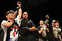 "FAIRFAX, VA - MAY 15:  ""The Korean Zombie"" Chan Sung Jung (L) reacts after defeating Dustin Poirier in a featherweight bout during the UFC on Fuel TV event at Patriot Center on May 15, 2012 in Fairfax, Virginia.  (Photo by Josh Hedges/Zuffa LLC/Zuffa LLC via Getty Images)"