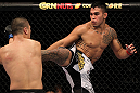FAIRFAX, VA - MAY 15:  (R-L) Brad Tavares kicks Dongi Yang in a middleweight bout during the UFC on Fuel TV event at Patriot Center on May 15, 2012 in Fairfax, Virginia.  (Photo by Josh Hedges/Zuffa LLC/Zuffa LLC via Getty Images)