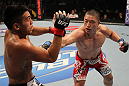 FAIRFAX, VA - MAY 15:  (R-L) Dongi Yang punches Brad Tavares in a middleweight bout during the UFC on Fuel TV event at Patriot Center on May 15, 2012 in Fairfax, Virginia.  (Photo by Josh Hedges/Zuffa LLC/Zuffa LLC via Getty Images)