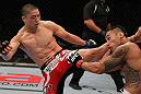 FAIRFAX, VA - MAY 15:  (L-R) Dongi Yang kicks Brad Tavares in a middleweight bout during the UFC on Fuel TV event at Patriot Center on May 15, 2012 in Fairfax, Virginia.  (Photo by Josh Hedges/Zuffa LLC/Zuffa LLC via Getty Images)