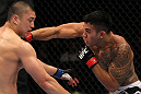 FAIRFAX, VA - MAY 15:  (R-L) Brad Tavares punches Dongi Yang in a middleweight bout during the UFC on Fuel TV event at Patriot Center on May 15, 2012 in Fairfax, Virginia.  (Photo by Josh Hedges/Zuffa LLC/Zuffa LLC via Getty Images)