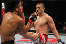 FAIRFAX, VA - MAY 15:  (R-L) Dongi Yang kicks Brad Tavares in a middleweight bout during the UFC on Fuel TV event at Patriot Center on May 15, 2012 in Fairfax, Virginia.  (Photo by Josh Hedges/Zuffa LLC/Zuffa LLC via Getty Images)