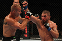 FAIRFAX, VA - MAY 15:  (R-L) Jeremy Stephens punches Donald &quot;Cowboy&quot; Cerrone in a lightweight bout during the UFC on Fuel TV event at Patriot Center on May 15, 2012 in Fairfax, Virginia.  (Photo by Josh Hedges/Zuffa LLC/Zuffa LLC via Getty Images)
