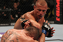 "FAIRFAX, VA - MAY 15:  (R-L) Donald ""Cowboy"" Cerrone delivers an elbow strike against Jeremy Stephens in a lightweight bout during the UFC on Fuel TV event at Patriot Center on May 15, 2012 in Fairfax, Virginia.  (Photo by Josh Hedges/Zuffa LLC/Zuffa LLC via Getty Images)"