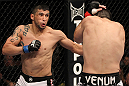 FAIRFAX, VA - MAY 15:  (L-R) Jorge Lopez punches Amir Sadollah in a welterweight bout during the UFC on Fuel TV event at Patriot Center on May 15, 2012 in Fairfax, Virginia.  (Photo by Josh Hedges/Zuffa LLC/Zuffa LLC via Getty Images)