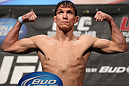 LAS VEGAS, NV - MAY 25:   Darren Elkins makes weight during the UFC 146 official weigh in at the MGM Grand Garden Arena on May 25, 2012 in Las Vegas, Nevada.  (Photo by Josh Hedges/Zuffa LLC/Zuffa LLC via Getty Images)
