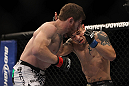 LAS VEGAS, NV - MAY 26:  Mike Brown (left) punches Daniel Pineda during a light featherweight bout at UFC 146 at MGM Grand Garden Arena on May 26, 2012 in Las Vegas, Nevada.  (Photo by Josh Hedges/Zuffa LLC/Zuffa LLC via Getty Images)