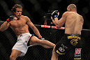 LAS VEGAS, NV - MAY 26:  Kyle Kingsbury (left) kicks Glover Teixeira during a light heavyweight bout at UFC 146 at MGM Grand Garden Arena on May 26, 2012 in Las Vegas, Nevada.  (Photo by Josh Hedges/Zuffa LLC/Zuffa LLC via Getty Images)