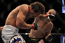 LAS VEGAS, NV - MAY 26:  Glover Teixeira (right) punches Kyle Kingsbury during a light heavyweight bout at UFC 146 at MGM Grand Garden Arena on May 26, 2012 in Las Vegas, Nevada.  (Photo by Josh Hedges/Zuffa LLC/Zuffa LLC via Getty Images)