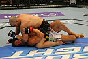 LAS VEGAS, NV - MAY 26:  Glover Teixeira (top) punches Kyle Kingsbury during a light heavyweight bout at UFC 146 at MGM Grand Garden Arena on May 26, 2012 in Las Vegas, Nevada.  (Photo by Donald Miralle/Zuffa LLC/Zuffa LLC via Getty Images)
