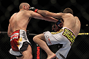 LAS VEGAS, NV - MAY 26:  (L-R) Paul Sass punches Jacob Volkmann during a lightweight bout at UFC 146 at MGM Grand Garden Arena on May 26, 2012 in Las Vegas, Nevada.  (Photo by Josh Hedges/Zuffa LLC/Zuffa LLC via Getty Images)