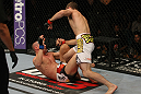 LAS VEGAS, NV - MAY 26:  Jacob Volkmann (white shorts) leans in to punch Paul Sass during a lightweight bout at UFC 146 at MGM Grand Garden Arena on May 26, 2012 in Las Vegas, Nevada.  (Photo by Donald Miralle/Zuffa LLC/Zuffa LLC via Getty Images)