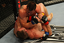 LAS VEGAS, NV - MAY 26:  CB Dollaway (top) punches Jason Miller during a middleweight bout at UFC 146 at MGM Grand Garden Arena on May 26, 2012 in Las Vegas, Nevada.  (Photo by Donald Miralle/Zuffa LLC/Zuffa LLC via Getty Images)