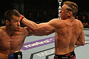 LAS VEGAS, NV - MAY 26:  CB Dollaway (L) punches Jason Miller during a middleweight bout at UFC 146 at MGM Grand Garden Arena on May 26, 2012 in Las Vegas, Nevada.  (Photo by Donald Miralle/Zuffa LLC/Zuffa LLC via Getty Images)