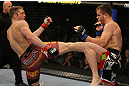 LAS VEGAS, NV - MAY 26:  Jason Miller (L) kicks CB Dollaway during a middleweight bout at UFC 146 at MGM Grand Garden Arena on May 26, 2012 in Las Vegas, Nevada.  (Photo by Donald Miralle/Zuffa LLC/Zuffa LLC via Getty Images)