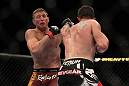LAS VEGAS, NV - MAY 26:  CB Dollaway (right) punches Jason Miller during a middleweight bout at UFC 146 at MGM Grand Garden Arena on May 26, 2012 in Las Vegas, Nevada.  (Photo by Josh Hedges/Zuffa LLC/Zuffa LLC via Getty Images)