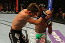 LAS VEGAS, NV - MAY 26:  Diego Brandao (R) punches Darren Elkins during a featherweight bout at UFC 146 at MGM Grand Garden Arena on May 26, 2012 in Las Vegas, Nevada.  (Photo by Donald Miralle/Zuffa LLC/Zuffa LLC via Getty Images)