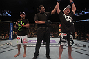 LAS VEGAS, NV - MAY 26:  Darren Elkins (R) is declared the winner in his fight against Diego Brandao during a featherweight bout at UFC 146 at MGM Grand Garden Arena on May 26, 2012 in Las Vegas, Nevada.  (Photo by Donald Miralle/Zuffa LLC/Zuffa LLC via Getty Images)