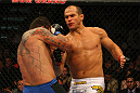 LAS VEGAS, NV - MAY 26:  Junior dos Santos (R) punches Frank Mir during the Heavyweight Championship bout at UFC 146 at MGM Grand Garden Arena on May 26, 2012 in Las Vegas, Nevada. (Photo by Donald Miralle/Zuffa LLC/Zuffa LLC via Getty Images)