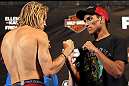 LAS VEGAS, NV - MAY 31:   (L-R) Opponents Jonathan Brookins and Charles Oliveira face off after making weight during The Ultimate Fighter Live weigh in at the Palms Casino Resort on May 31, 2012 in Las Vegas, Nevada.  (Photo by Josh Hedges/Zuffa LLC/Zuffa LLC via Getty Images)  *** Local Caption *** Jonathan Brookins; Charles Oliveira