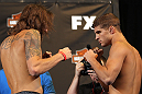 LAS VEGAS, NV - MAY 31:   (L-R) Opponents Michael Chiesa and Al Iaquinta face off after making weight during The Ultimate Fighter Live weigh in at the Palms Casino Resort on May 31, 2012 in Las Vegas, Nevada.  (Photo by Josh Hedges/Zuffa LLC/Zuffa LLC via Getty Images)  *** Local Caption *** Michael Chiesa; Al Iaquinta