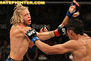 LAS VEGAS, NV - JUNE 01:   (L-R) Jonathan Brookins punches Charles Oliveira in a Featherweight bout during The Ultimate Fighter Live Finale at the Pearl Theater at the Palms Casino Resort on June 1, 2012 in Las Vegas, Nevada.  (Photo by Josh Hedges/Zuffa LLC/Zuffa LLC via Getty Images)  *** Local Caption *** Jonathan Brookins; Charles Oliveira