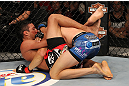 LAS VEGAS, NV - JUNE 01:   Charles Oliveira (left) attempts to submit Jonathan Brookins in a Featherweight bout during The Ultimate Fighter Live Finale at the Pearl Theater at the Palms Casino Resort on June 1, 2012 in Las Vegas, Nevada.  (Photo by Josh Hedges/Zuffa LLC/Zuffa LLC via Getty Images)  *** Local Caption *** Jonathan Brookins; Charles Oliveira