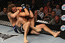 LAS VEGAS, NV - JUNE 01:   (L-R) Michael Chiesa attempts to submit Al Iaquinta in a Lightweight bout during The Ultimate Fighter Live Finale at the Pearl Theater at the Palms Casino Resort on June 1, 2012 in Las Vegas, Nevada.  (Photo by Josh Hedges/Zuffa LLC/Zuffa LLC via Getty Images)  *** Local Caption *** Al Iaquinta; Michael Chiesa