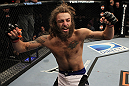 LAS VEGAS, NV - JUNE 01:   Michael Chiesa reacts to his submission victory in a Lightweight bout against Al Iaquinta during The Ultimate Fighter Live Finale at the Pearl Theater at the Palms Casino Resort on June 1, 2012 in Las Vegas, Nevada.  (Photo by Josh Hedges/Zuffa LLC/Zuffa LLC via Getty Images)  *** Local Caption *** Michael Chiesa