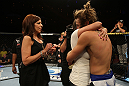 LAS VEGAS, NV - JUNE 01:   Michael Chiesa (right) embraces his sister during The Ultimate Fighter Live Finale at the Pearl Theater at the Palms Casino Resort on June 1, 2012 in Las Vegas, Nevada.  (Photo by Josh Hedges/Zuffa LLC/Zuffa LLC via Getty Images)  *** Local Caption *** Michael Chiesa
