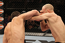 LAS VEGAS, NV - JUNE 01:   (L-R) Jake Ellenberger punches Martin Kampmann in a Welterweight bout during The Ultimate Fighter Live Finale at the Pearl Theater at the Palms Casino Resort on June 1, 2012 in Las Vegas, Nevada.  (Photo by Josh Hedges/Zuffa LLC/Zuffa LLC via Getty Images)  *** Local Caption *** Jake Ellenberger; Martin Kampmann