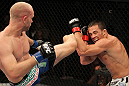 LAS VEGAS, NV - JUNE 01:   Martin Kampmann (left) kicks Jake Ellenberger in a Welterweight bout during The Ultimate Fighter Live Finale at the Pearl Theater at the Palms Casino Resort on June 1, 2012 in Las Vegas, Nevada.  (Photo by Josh Hedges/Zuffa LLC/Zuffa LLC via Getty Images)  *** Local Caption *** Jake Ellenberger; Martin Kampmann