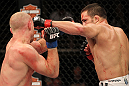 LAS VEGAS, NV - JUNE 01:   (R-L) Jake Ellenberger punches Martin Kampmann in a Welterweight bout during The Ultimate Fighter Live Finale at the Pearl Theater at the Palms Casino Resort on June 1, 2012 in Las Vegas, Nevada.  (Photo by Josh Hedges/Zuffa LLC/Zuffa LLC via Getty Images)  *** Local Caption *** Jake Ellenberger; Martin Kampmann