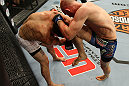 LAS VEGAS, NV - JUNE 01:   (R-L) Martin Kampmann hits Jake Ellenberger with a knee in a Welterweight bout during The Ultimate Fighter Live Finale at the Pearl Theater at the Palms Casino Resort on June 1, 2012 in Las Vegas, Nevada.  (Photo by Josh Hedges/Zuffa LLC/Zuffa LLC via Getty Images)  *** Local Caption *** Jake Ellenberger; Martin Kampmann