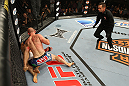 LAS VEGAS, NV - JUNE 01:   Martin Kampmann (blue shorts) attempts to finish Jake Ellenberger as referee Steve Mazzagatti (right) observes in a Welterweight bout during The Ultimate Fighter Live Finale at the Pearl Theater at the Palms Casino Resort on June 1, 2012 in Las Vegas, Nevada.  (Photo by Josh Hedges/Zuffa LLC/Zuffa LLC via Getty Images)  *** Local Caption *** Jake Ellenberger; Martin Kampmann