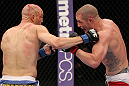 SUNRISE, FL - JUNE 08:   (L-R) Sean Pierson punches Jake Hecht in Welterweight bout during the UFC on FX 3 event at Bank Atlantic Center on June 8, 2012 in Sunrise, Florida.  (Photo by Josh Hedges/Zuffa LLC/Zuffa LLC via Getty Images)