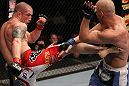 SUNRISE, FL - JUNE 08:   (L-R) Jake Hecht kicks Sean Pierson in Welterweight bout during the UFC on FX 3 event at Bank Atlantic Center on June 8, 2012 in Sunrise, Florida.  (Photo by Josh Hedges/Zuffa LLC/Zuffa LLC via Getty Images)