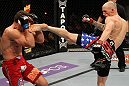 SUNRISE, FL - JUNE 08:   (R-L) Buddy Roberts kicks Caio Magalhaes in Middleweight bout during the UFC on FX 3 event at Bank Atlantic Center on June 8, 2012 in Sunrise, Florida.  (Photo by Josh Hedges/Zuffa LLC/Zuffa LLC via Getty Images)