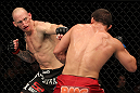 SUNRISE, FL - JUNE 08:   (L-R) Buddy Roberts punches Caio Magalhaes in Middleweight bout during the UFC on FX 3 event at Bank Atlantic Center on June 8, 2012 in Sunrise, Florida.  (Photo by Josh Hedges/Zuffa LLC/Zuffa LLC via Getty Images)