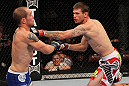 SUNRISE, FL - JUNE 08:   (R-L) Tim Means punches Justin Salas in Lightweight bout during the UFC on FX 3 event at Bank Atlantic Center on June 8, 2012 in Sunrise, Florida.  (Photo by Josh Hedges/Zuffa LLC/Zuffa LLC via Getty Images)