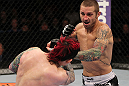 SUNRISE, FL - JUNE 08:   (R-L) Eddie Wineland punches Scott Jorgensen in a Bantamweight bout during the UFC on FX 3 event at Bank Atlantic Center on June 8, 2012 in Sunrise, Florida.  (Photo by Josh Hedges/Zuffa LLC/Zuffa LLC via Getty Images)
