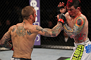 SUNRISE, FL - JUNE 08:   (L-R) Eddie Wineland punches Scott Jorgensen in a Bantamweight bout during the UFC on FX 3 event at Bank Atlantic Center on June 8, 2012 in Sunrise, Florida.  (Photo by Josh Hedges/Zuffa LLC/Zuffa LLC via Getty Images)