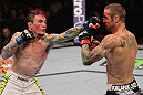 SUNRISE, FL - JUNE 08:   (L-R) Scott Jorgensen punches Eddie Wineland in a Bantamweight bout during the UFC on FX 3 event at Bank Atlantic Center on June 8, 2012 in Sunrise, Florida.  (Photo by Josh Hedges/Zuffa LLC/Zuffa LLC via Getty Images)