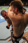 SUNRISE, FL - JUNE 08:   (L-R) Josh Neer punches Mike Pyle in a Welterweight bout during the UFC on FX 3 event at Bank Atlantic Center on June 8, 2012 in Sunrise, Florida.  (Photo by Josh Hedges/Zuffa LLC/Zuffa LLC via Getty Images)