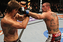 SUNRISE, FL - JUNE 08:   (R-L) Josh Neer punches Mike Pyle in a Welterweight bout during the UFC on FX 3 event at Bank Atlantic Center on June 8, 2012 in Sunrise, Florida.  (Photo by Josh Hedges/Zuffa LLC/Zuffa LLC via Getty Images)