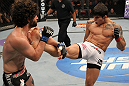 SUNRISE, FL - JUNE 08:   (R-L) Erick Silva kicks Charlie Brenneman in a Welterweight bout during the UFC on FX 3 event at Bank Atlantic Center on June 8, 2012 in Sunrise, Florida.  (Photo by Josh Hedges/Zuffa LLC/Zuffa LLC via Getty Images)