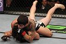 SUNRISE, FL - JUNE 08:   (R-L) Erick Silva defeats Charlie Brenneman with a rear choke submission in a Welterweight bout during the UFC on FX 3 event at Bank Atlantic Center on June 8, 2012 in Sunrise, Florida.  (Photo by Josh Hedges/Zuffa LLC/Zuffa LLC via Getty Images)