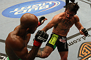 SUNRISE, FL - JUNE 08:   (R-L) Ian McCall kicks Demetrious Johnson in a Flyweight bout during the UFC on FX 3 event at Bank Atlantic Center on June 8, 2012 in Sunrise, Florida.  (Photo by Josh Hedges/Zuffa LLC/Zuffa LLC via Getty Images)
